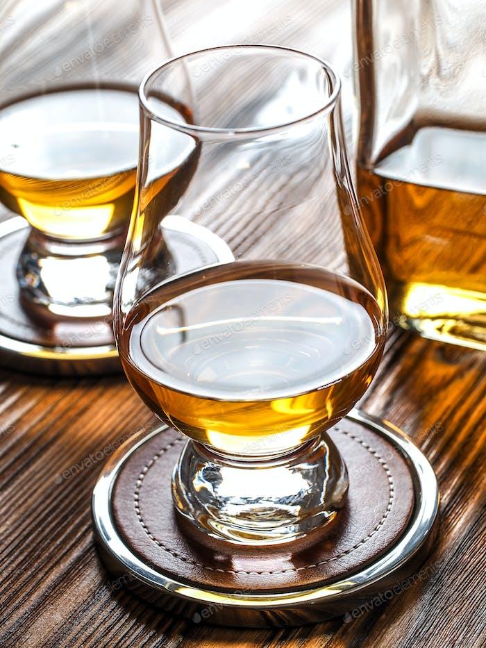 Two glencairn glasses of whisky