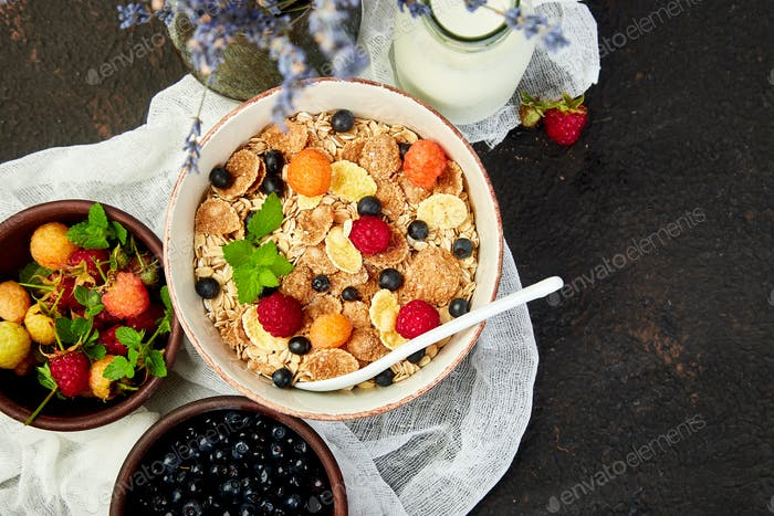 Healthy vegetarian breakfast. Oatmeal, granola with raspberries