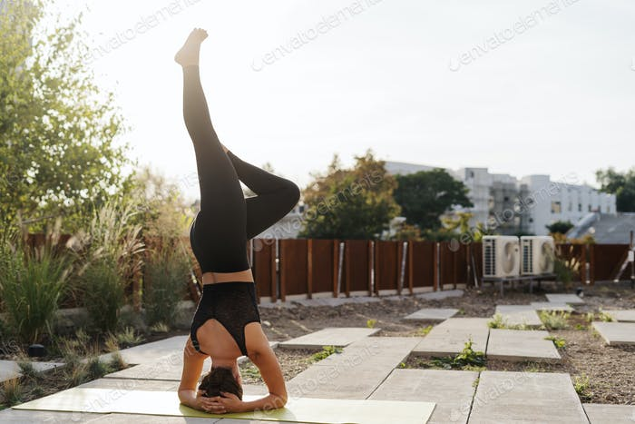 Young girl practicing stretching and yoga workout exercise