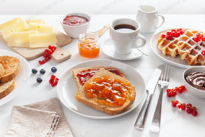 breakfast with waffle, toast, berry, jam and coffee