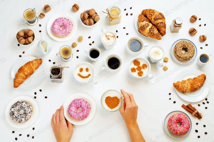 White background with woman's hand and different types of coffee