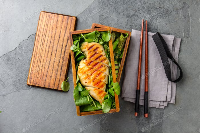 Healthy Lunch in Wooden Japanese Bento Box, Grilled Chicken, Avocado, Asparagus