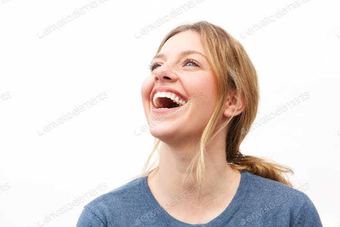Close up attractive young woman laughing against white background