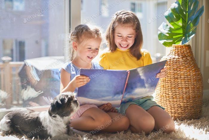 girls are reading a book