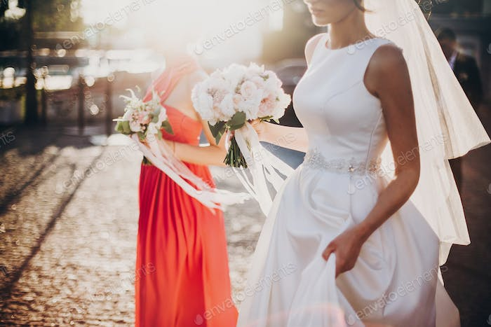 Gorgeous bride walking with bridesmaids