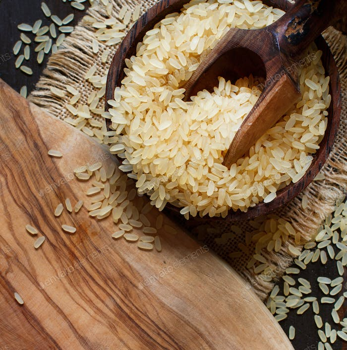 Parboiled rice with a wooden spoon