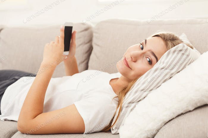 Girl at home chatting online on smartphone