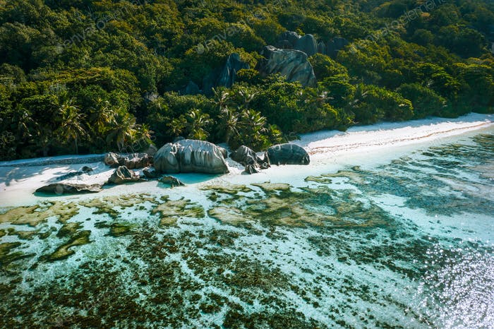Anse Source d'Argent beach at La Digue island, Seychelles from drone aerial perspective