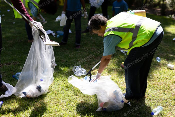 Multi-generation mixed race family collecting garbage