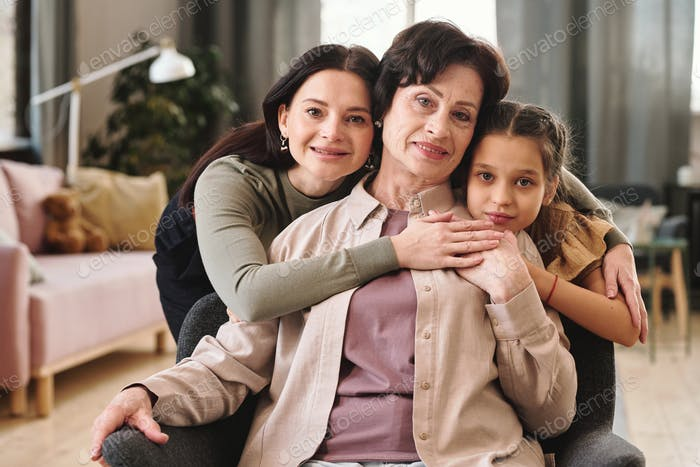 Females of three generations in front of camera