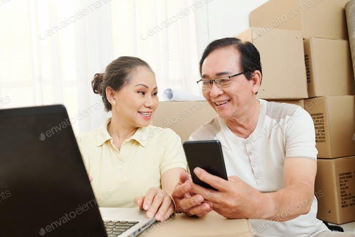Senior couple preparing for move