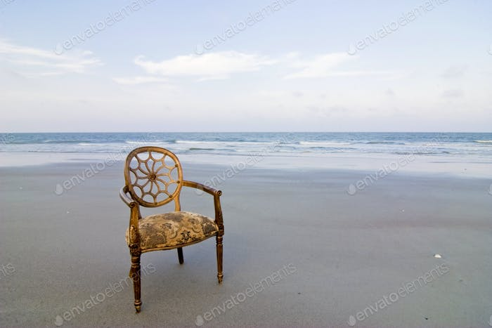 ornate chair on beach