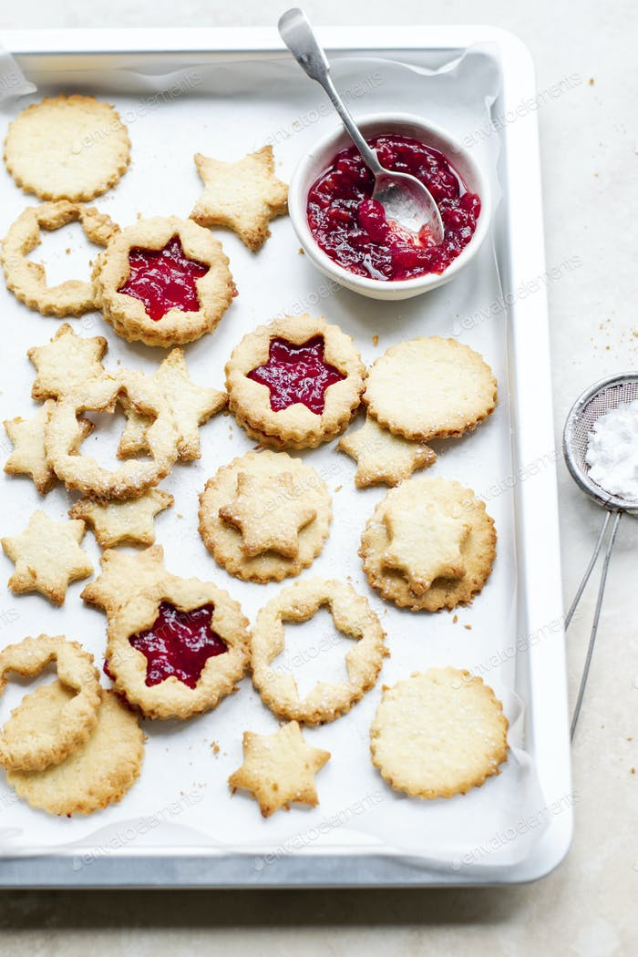 Star shaped cookies filled with cranberry sauce