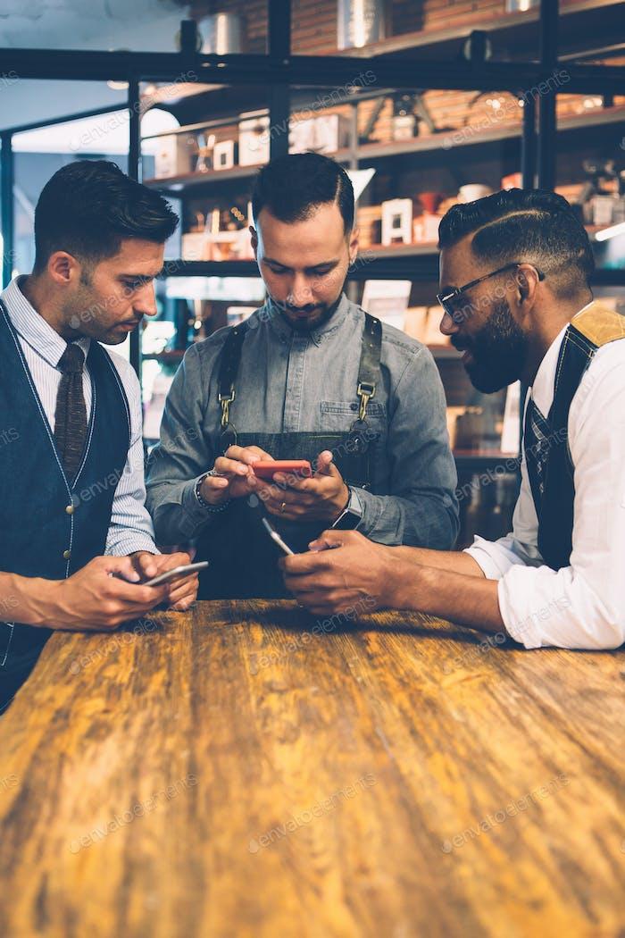 Handsome men using mobile phones