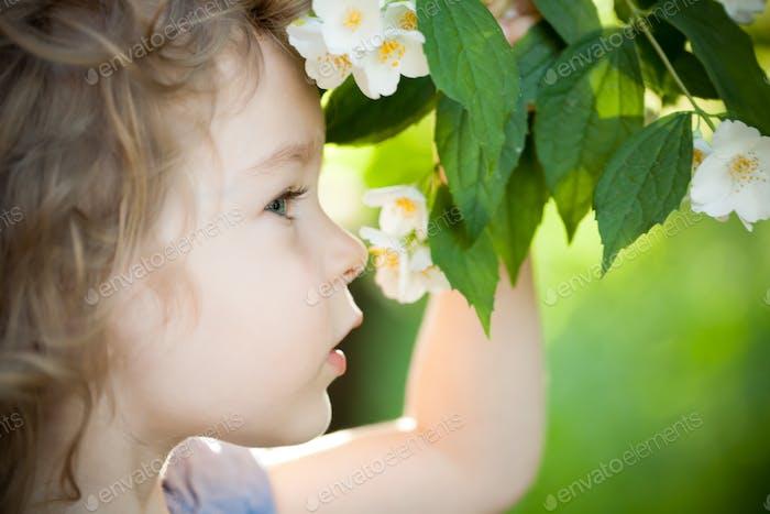 Child with jasmin flower