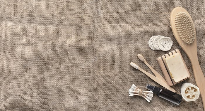 Spa organic natural accessories of bamboo on brown towel