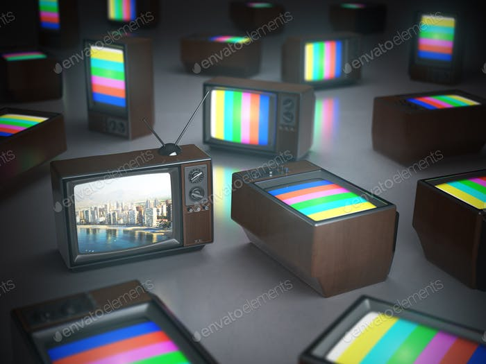 Pile of vintage TV with one in standby. TV channels concept