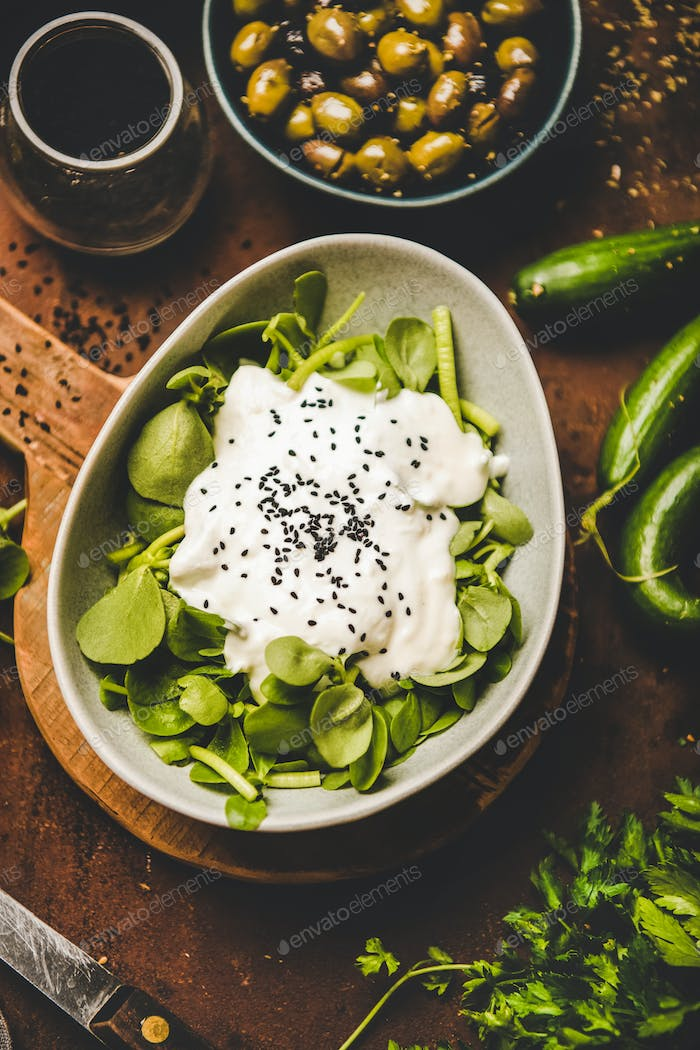 Fresh green purslane salad with yogurt, black sesame and vegetables