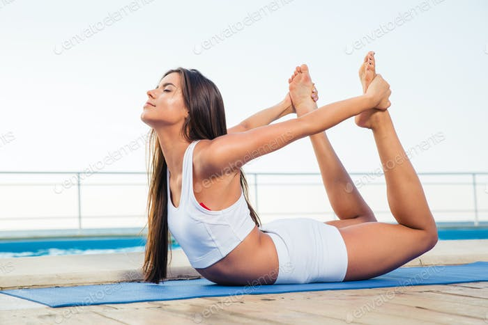 Girl doing stretching exercises outdoors
