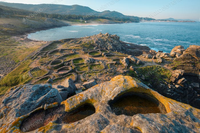 The ruins of a millennial Celtic Castro on a rocky isthmus