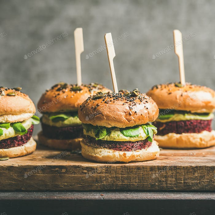 Vegan burgers with beetroot patties and green sprouts, square crop