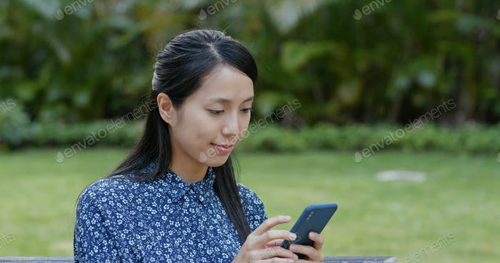 Woman use of cellphone at park
