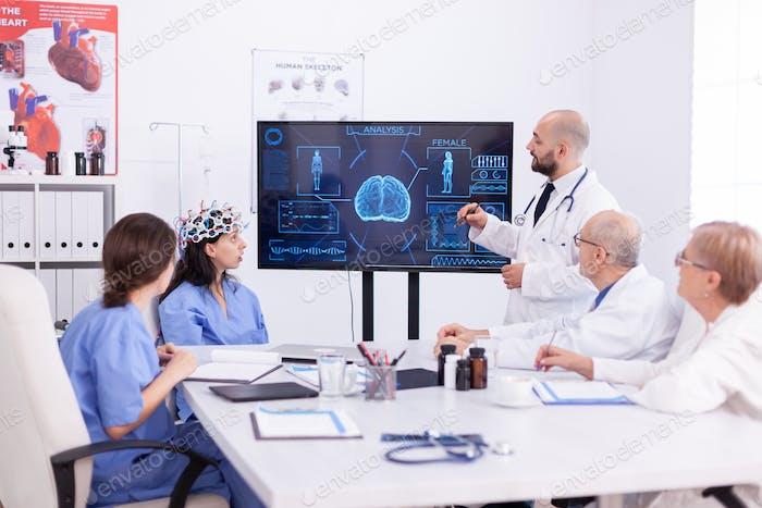 Nurse wearing headset with sensors