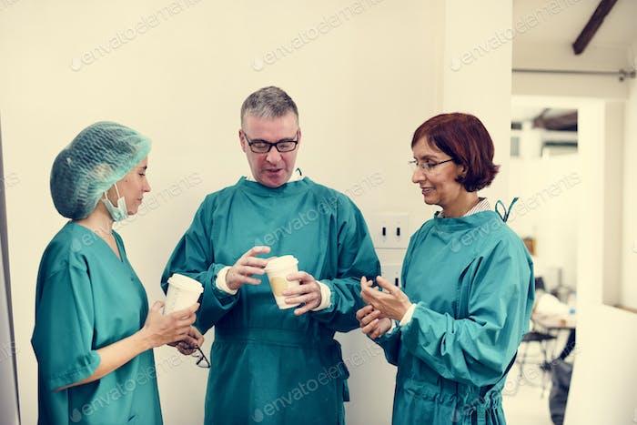 Doctors talking together during break time