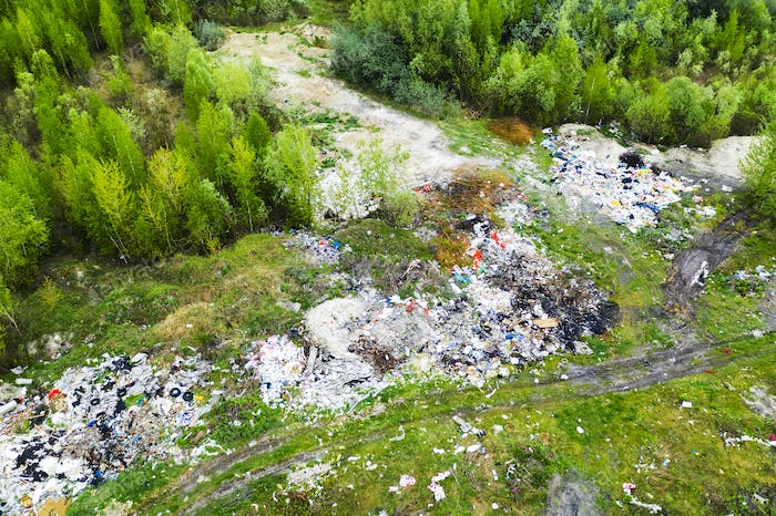 Aerial view of dump in forest. Pollution concept, top view