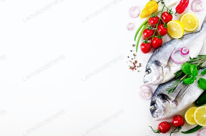 Uncooked fish on dark vintage background. Free space for your text. Copy space