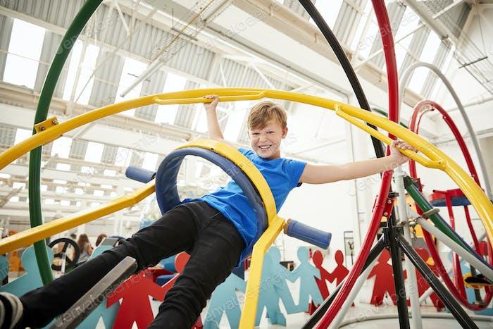 Young white boy having fun using a human gyroscope