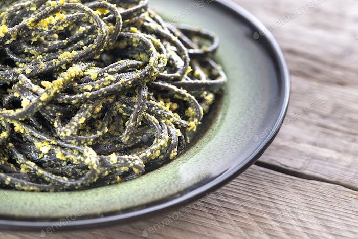 Black pasta with pesto sauce