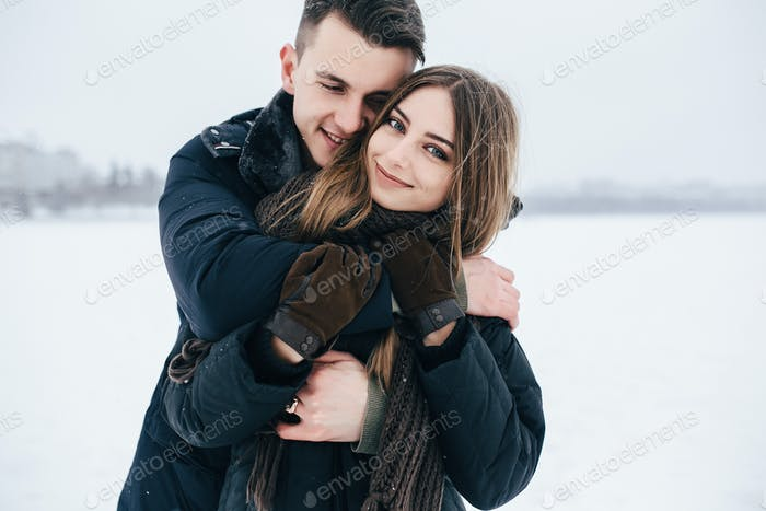 boy hugging a girl from behind