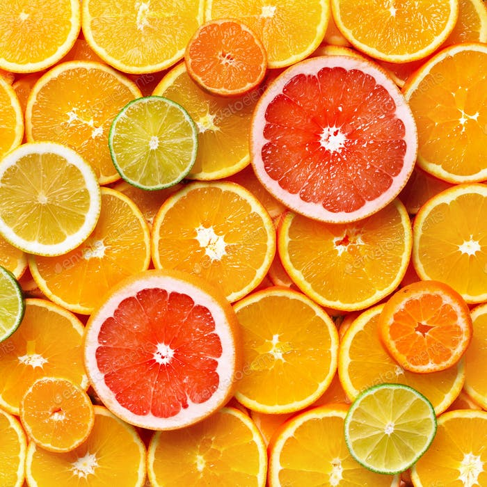 Isolated citrus fruits. Pieces of lemon, lime, pink grapefruit and orange isolated on white
