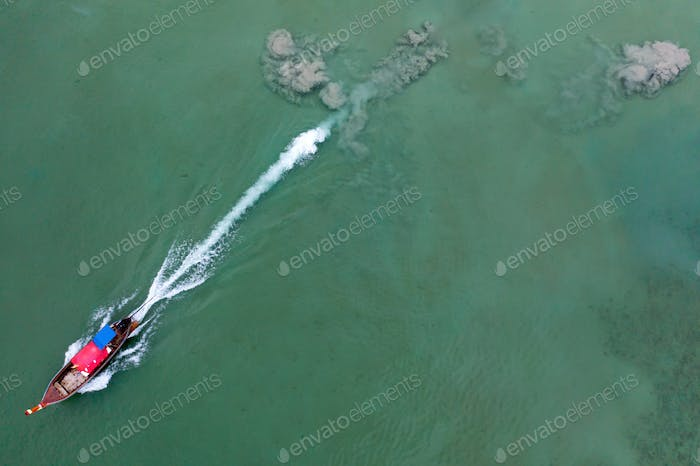 Aerial view of traditional longtail boats floating on a turquois