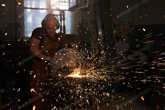 Welder working with metal