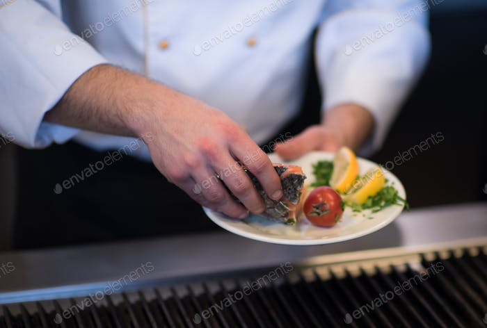 chef hands cooking grilled salmon fish