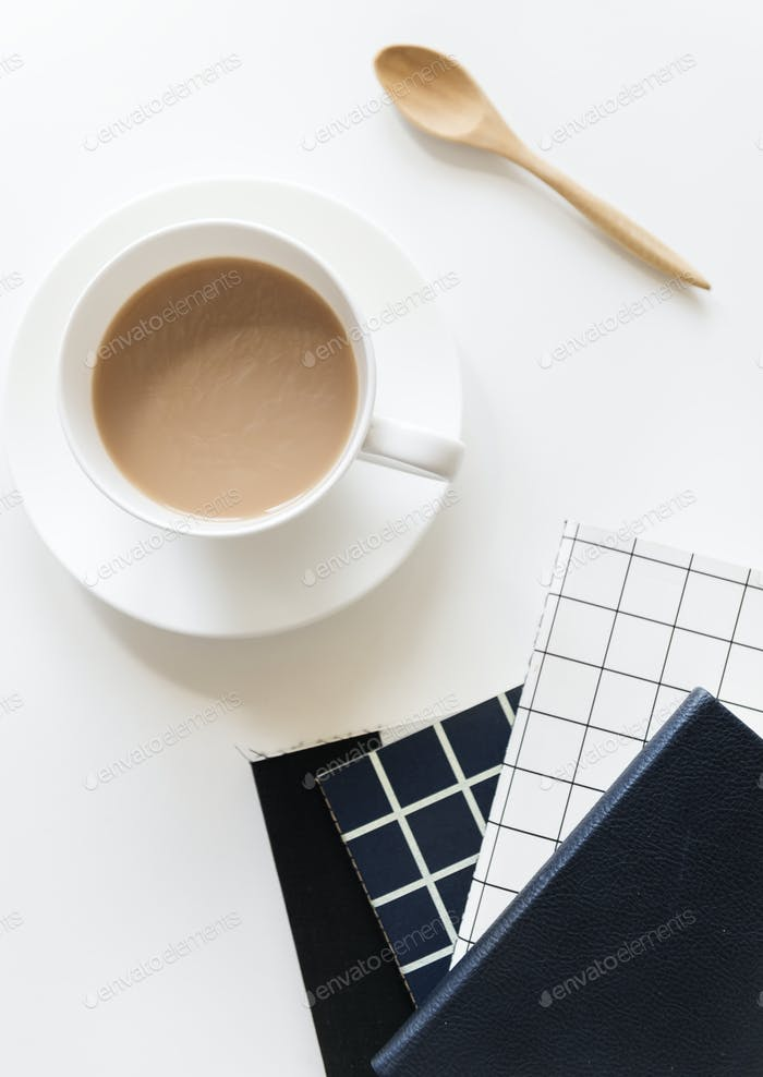 Aerial view of coffe cup with notepads
