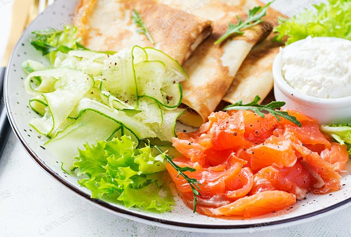 Crepes with salted salmon, cream cheese and salad.