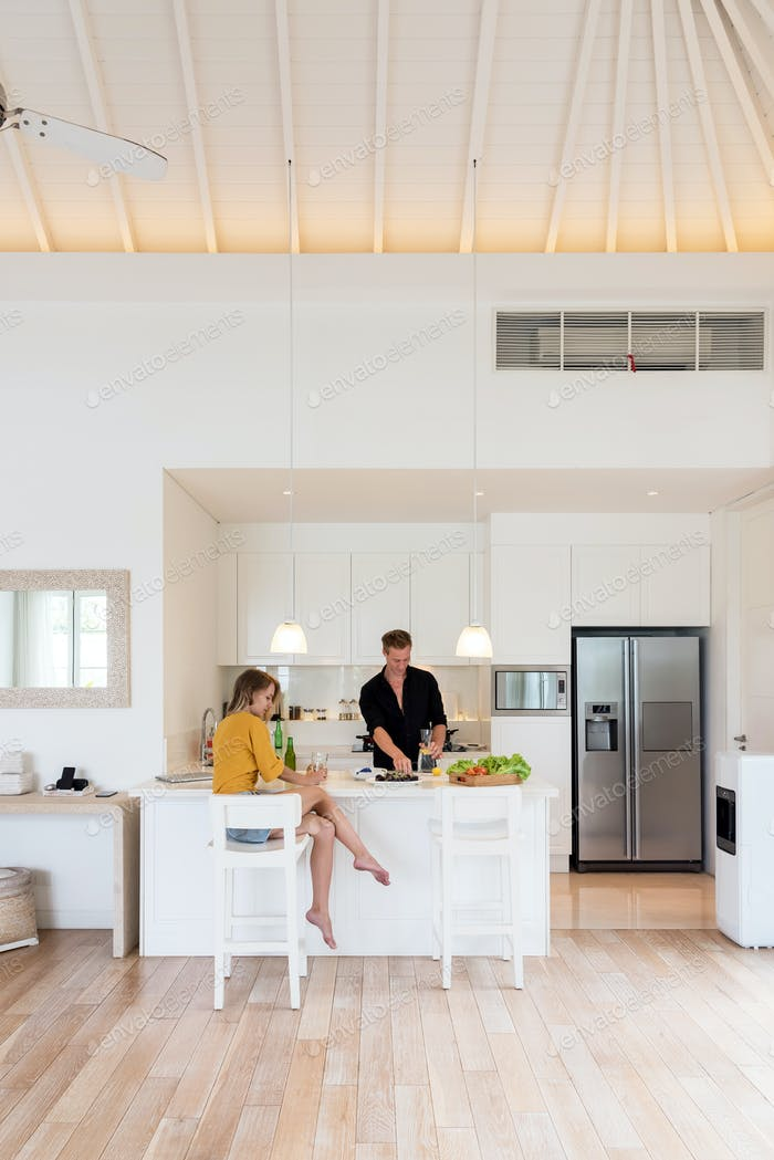 Couple making lunch on a withe kitchen at home