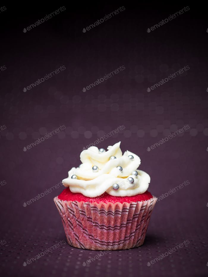 red cupcake purple background