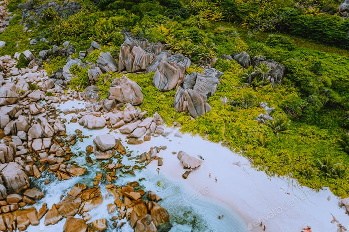 Aerial view of Seychelles tropical Marron beach at La Digue island. White sand beach with turquoise