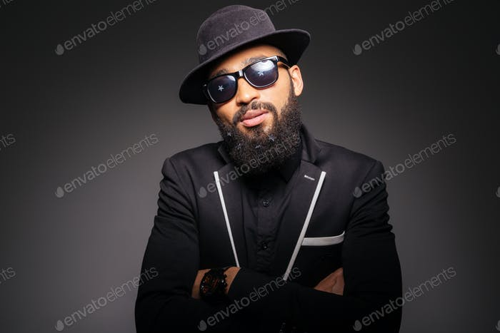 Serious afro american man in fashion cloth and glasses