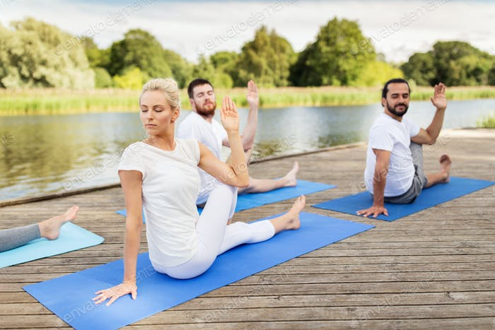 people making yoga in half lord of the fishes pose