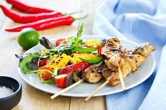 Grilled chicken skewer with salad