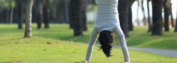 Handstand on grass in park