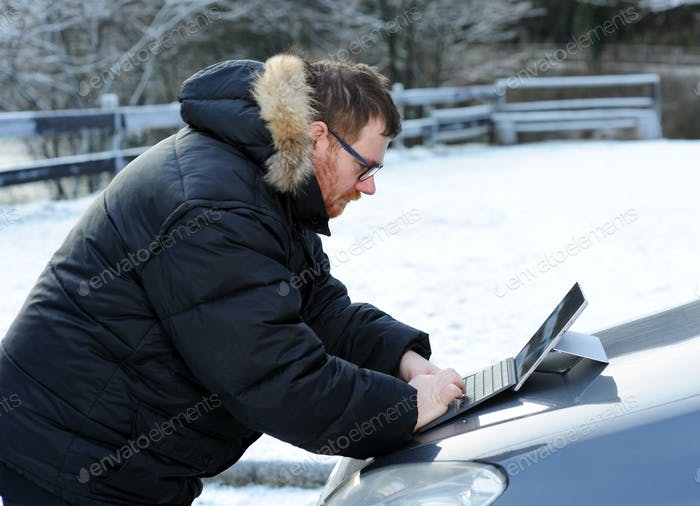 man using tablet on the car