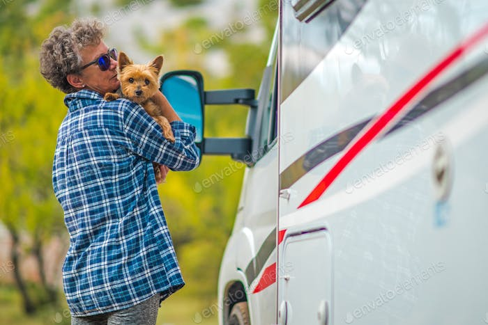 Retired Woman on the Road Trip with Her Dog