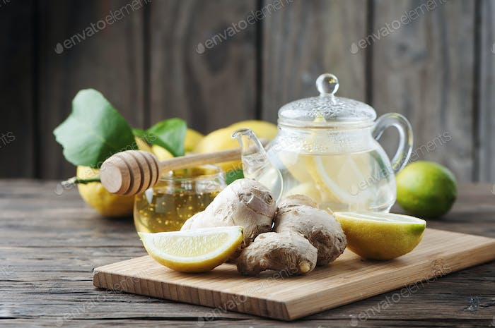 Cocktail with ginger, lemon and honey on the wooden table