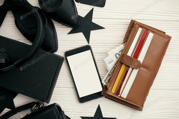 Wallet with credit cards and money, phone, black bag, gift box, price tags, shoes